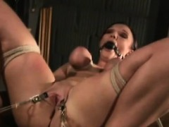busty-brunette-feels-the-pain-of-tight-boobs-bondage