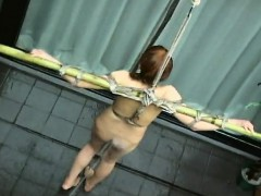 tied-up-asian-babe-soaked-with-a-water-hose