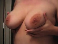 Attractive Lady Sensually Massages Her Big Natural Tits For