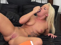 buxom-blonde-cali-carter-finds-comfort-and-pleasure-in-a-purple-dildo