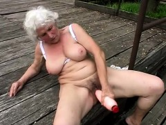 stacked-mature-woman-fucks-a-big-dildo-and-works-her-mouth-on-a-cock