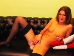 sensuous-redhead-in-black-stockings-fucks-her-tight-slit-on
