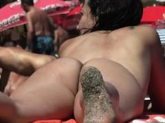 Uninhibited Young Woman Enjoys Sunbathing Without Her Swims