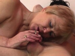 mature-blonde-mama-sucks-young-cock-while-smoking