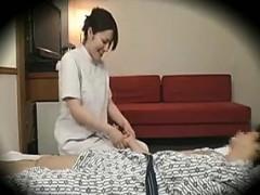 beautiful-asian-masseuse-strokes-a-man-s-hard-cock-through