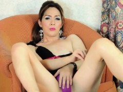 asian-ladyboy-toying-her-ass-with-dildo