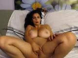 Brunette revealing her huge natural tits
