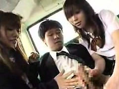 two-attractive-japanese-schoolgirls-work-their-hands-on-a-s