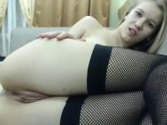 blonde-in-a-bra-stockings-and-panties-masturbating