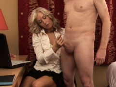 classy-milf-dressed-up-while-wanking-cock