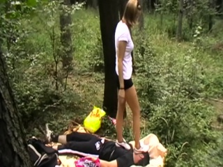 Girls trample slaves outdoor