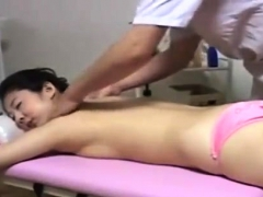 japanese-milf-lies-nude-for-sensual-erotic-oil-massage