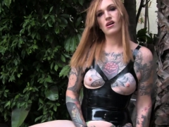Inked transsexual tugging herself outdoors
