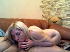 teen-blonde-handling-two-big-cocks