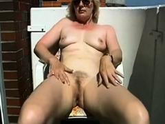 mature-masturbating-on-the-balcony