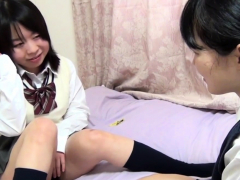 Asian students rubbing