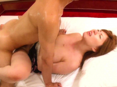 Sweet Japanese girl has a threesome on the bed