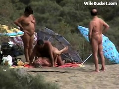 spying-swinger-couple-fucking-at-the-beach
