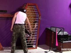 twink-sub-bound-in-cage-and-tormented-by-skinny-dom