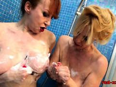 mature-redhead-plays-in-the-shower-with-her-girlfriend