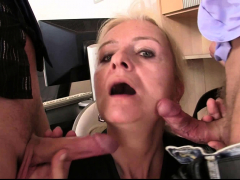 skinny-old-blonde-swallows-two-cocks-for-work