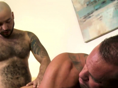 two-tattooed-guys-sniffing-shorts