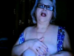 Russian granny ex-teacher flashing her big tits on webcam