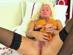 British mature Ellen stuffs her fanny with orange knickers