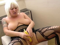 mesmerizing-milf-in-stockings-uses-a-banana