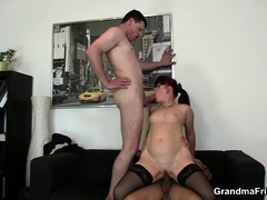 sexy-office-mature-boss-swallows-two-cocks-at-once