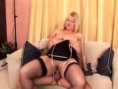 busty-blonde-in-black-stockings-fucks-two-cocks