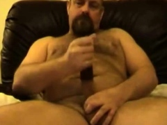 daddy-bear-playing-with-cock-and-sex-toy