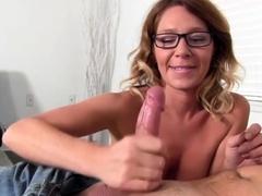busty-milf-jerking-a-big-cock