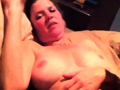 brunette amateur slut eating a hard lusty pecker in close up