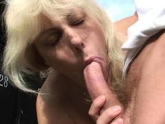 Horny guy fucks 70 years old blonde granny in public