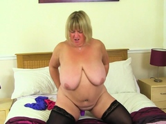 BBW milf Melons Marie rides a dildo on the bed