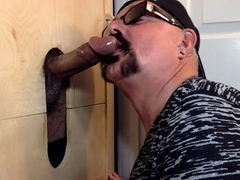 Gloryhole DILF sucking and tugging black cock