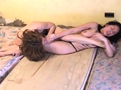 catfight Aggressive topless catfight with biting, face