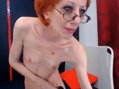 amazing-skinny-gilf-fucks-her-dildo-standing-up