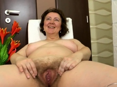 mature-woman-spreads-her-legs-and-shows-her-big-fleshy
